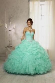 58743c43b3b You can share these sweet 15 dresses turquoise and gold on Facebook