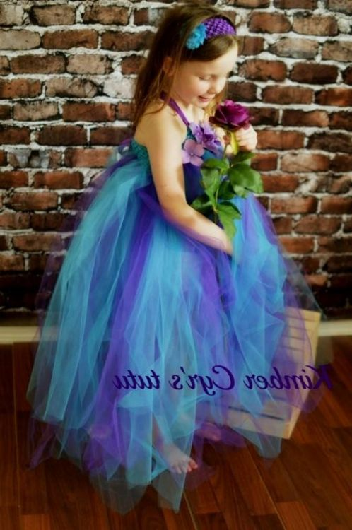 cdf0970e6cd See kids dresses in the latest designs and the hottest colors of the  season. You can share these turquoise and purple flower girl dresses on  Facebook ...