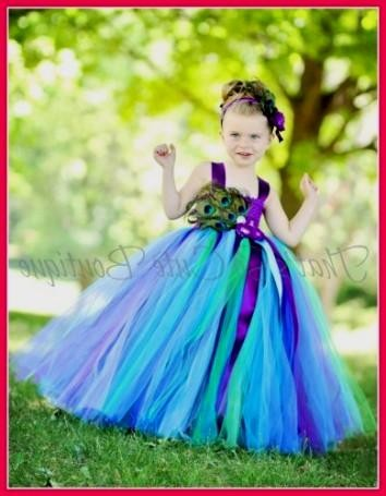 12995b1863b You can share these turquoise and purple flower girl dresses on Facebook